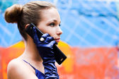 Teenager girl in blue talk by phone — Stock Photo