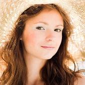 Smiling girl in straw hat — Stock Photo