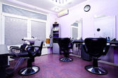 Armchairs in hairdressing salon — Stock Photo