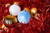 Tinsel and christmas balls — Stock Photo