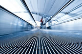Moving blue travolator in airport — Stock Photo
