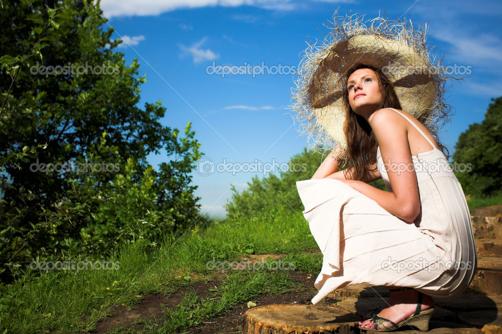 Smiling girl in hat under sun  Stock Photo #1380247