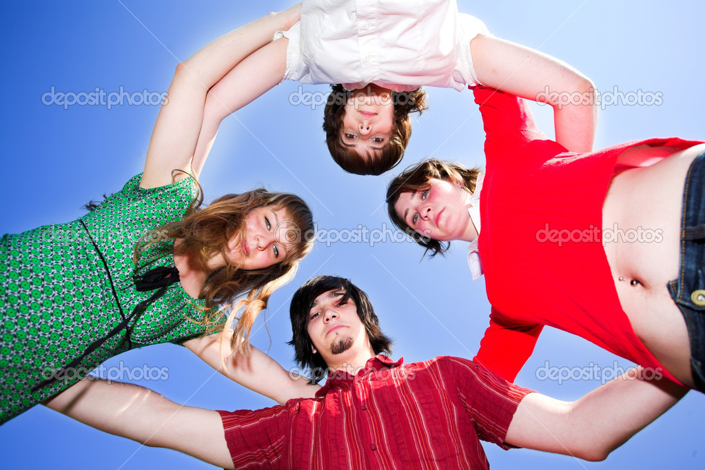 Four friends circle on blue sky — Stock Photo #1380865