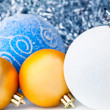 Стоковое фото: White tinsel and christmas balls