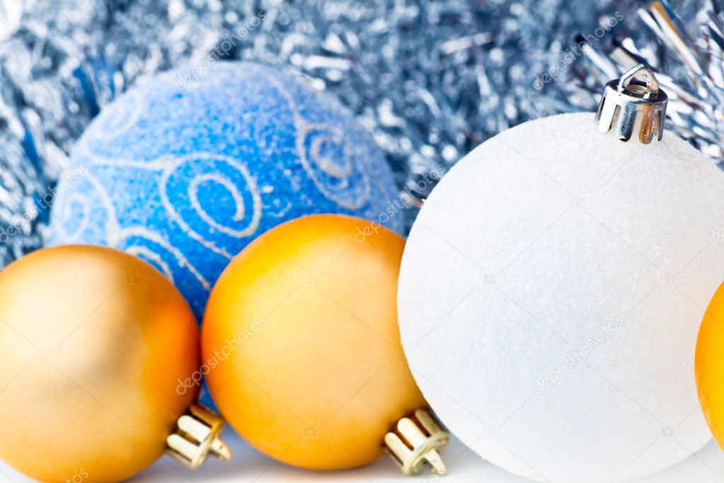 White tinsel and christmas balls (gold,white, blue) — Stock Photo #1505908