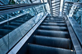Moving up escalator — Stock fotografie