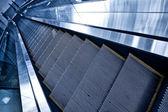 Moving down escalator — Stock Photo