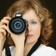 The woman with the camera — Stock Photo