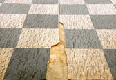 Old crackled chessboard — Stock Photo