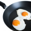 Stock Photo: Fried eggs on griddle
