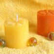 Aromatherapy candles on a towel — Stock Photo