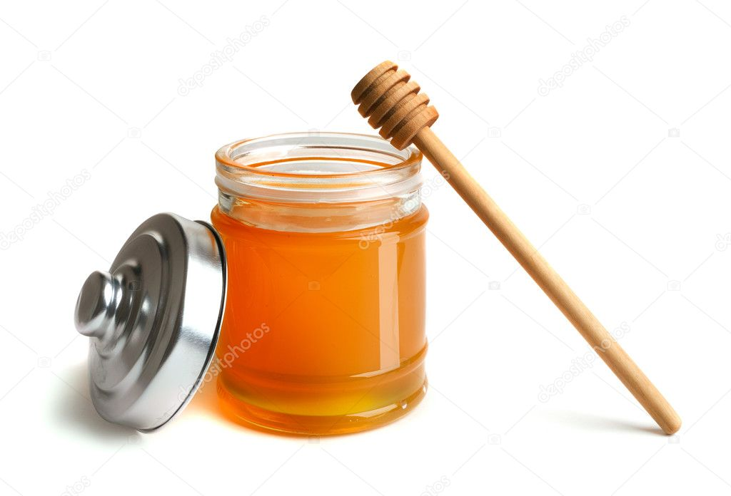 Honey pot and dipper on white background  Stock Photo #1219894