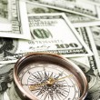 Vintage compass and money — Stock Photo