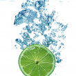 Lime slice in a water — Stock Photo #1295996