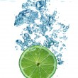 Lime slice in water — Stock Photo #1295996