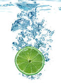 Lime slice in a water — Stock Photo