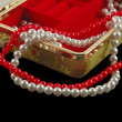 Casket with pearls isolated on black — Stock Photo