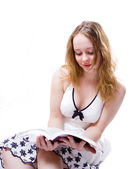 Attractive girl reading a over white bac — Stock Photo