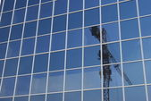 Crane in modern building glass — Stock Photo