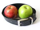 Two apples in a belt — Stock Photo