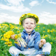 Happy kid with diadem and dandelions — Stock Photo #1204181