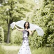 Beautiful ypung woman in summer park — Stock Photo #1205149