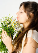 Girl and wildflowers — Stock Photo