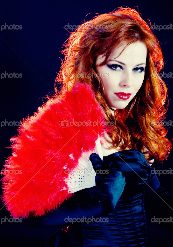 Smart young woman with red hair and fan  Stock Photo #1204702