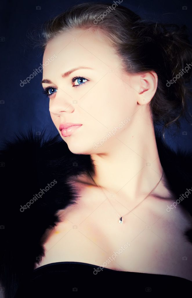 Beautiful stylish young woman with blue eyes  Stock Photo #1204989