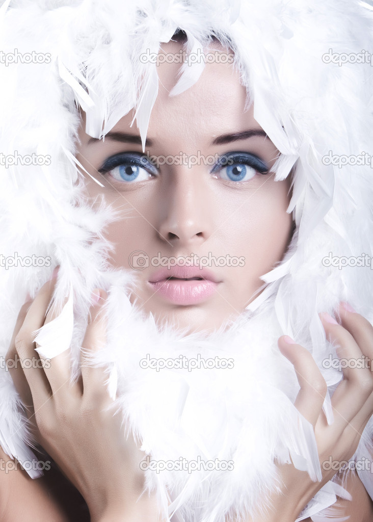 Beautiful young girl with swan feathers  Foto Stock #1206366