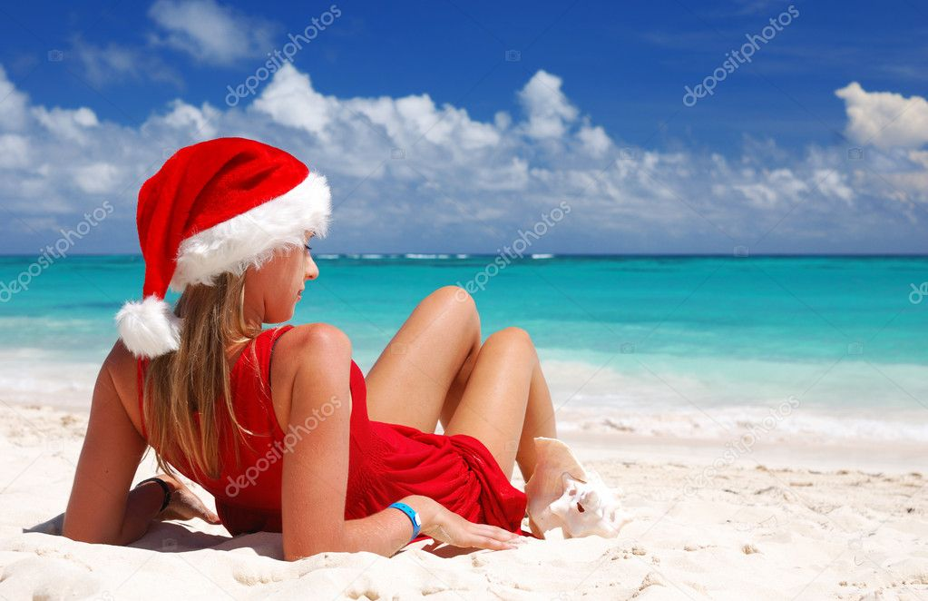 Woman on the beach in santa's hat  Stock Photo #1182403