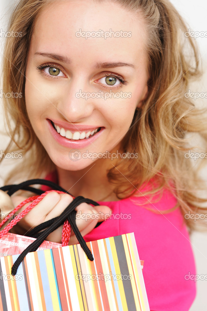 Woman with bags in shopping mall  Stock Photo #1189638