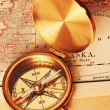 Antique brass compass over old map — 图库照片