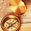 Antique brass compass over old map — Стоковое фото #1192756