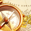 Antique brass compass over old Canadian - Stock Photo