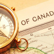 Antique brass compass over old Canadian — Stock Photo #1192867
