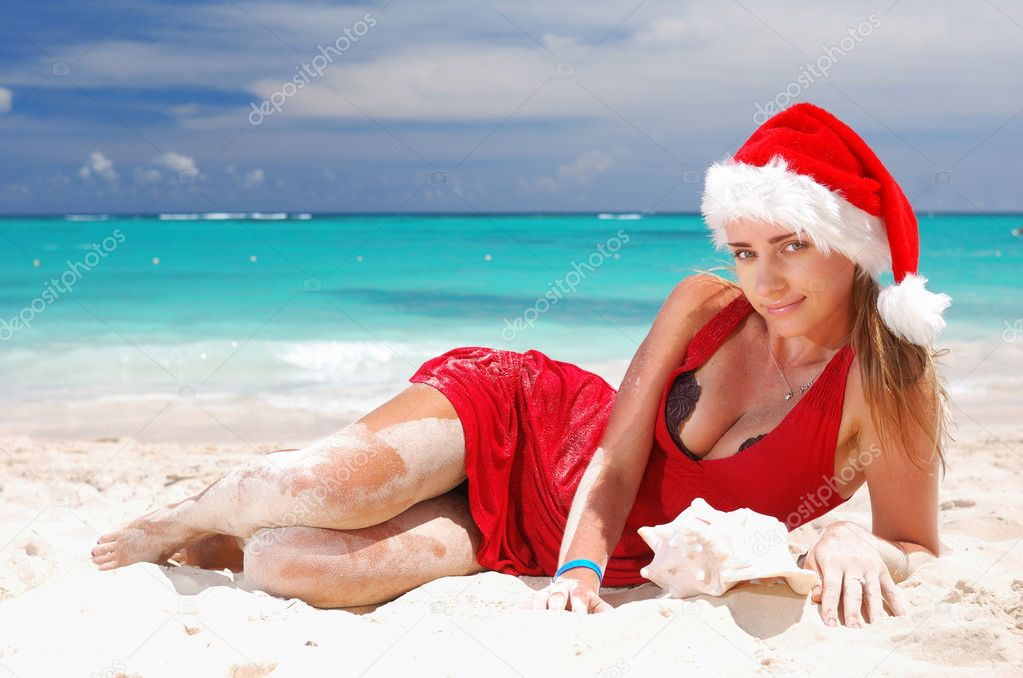 Woman on the beach in santa's hat  Stock Photo #1190510