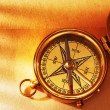 Stock Photo: Antique brass compass over old backgroun