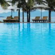 Tropical pool beside the sea - Stock Photo