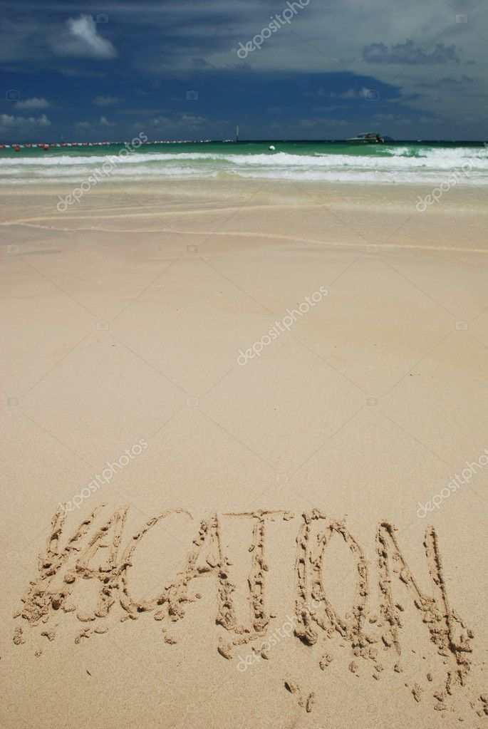 Vacation word written on a tropical beach — Stock Photo #1233779