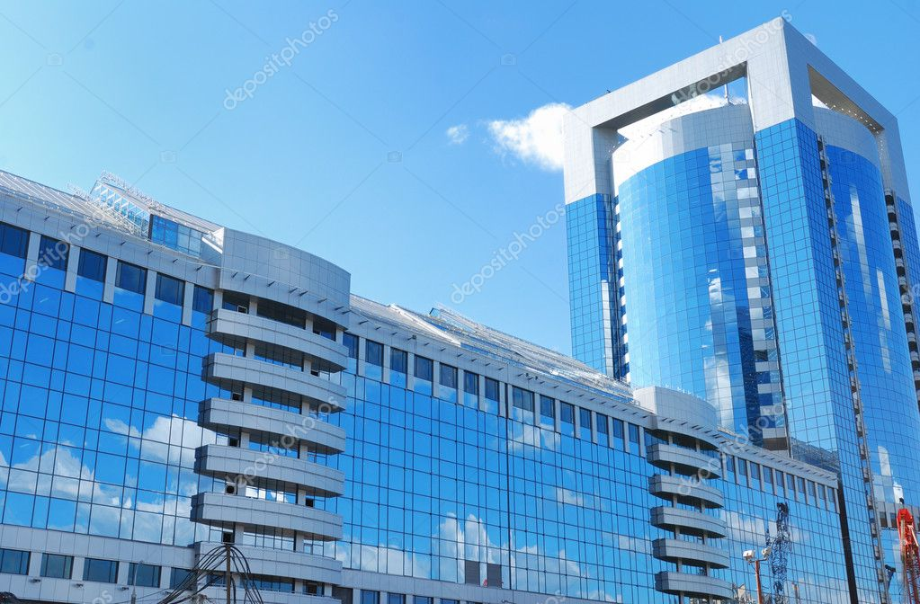 Modern office building with sky reflection in windows  Stock Photo #1234211
