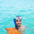 Snorkel with starfish — Stock Photo