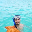 Snorkel with starfish — Stock Photo