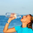 Drinking water after jogging — Stock Photo