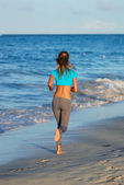 Jogging at beach — Stock Photo