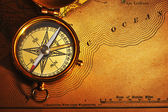 Antique brass compass over old USA map — Stock Photo