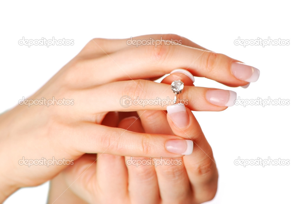 Woman tries on her diamond engagement ring   #1540744