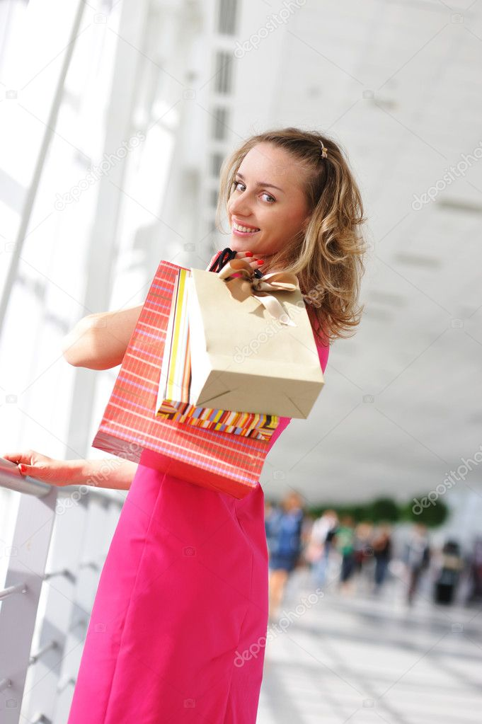 Woman with bags in shopping mall  Stock Photo #1543732
