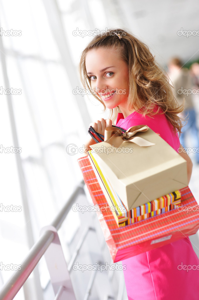Woman with bags in shopping mall — Stock Photo #1543740