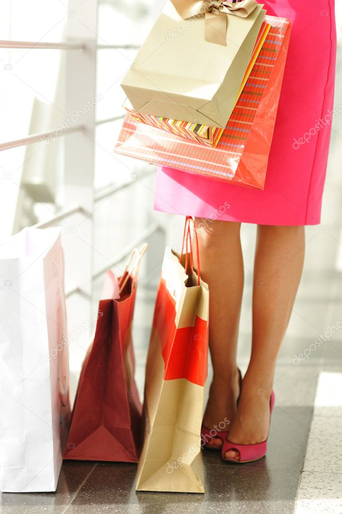 Woman with bags in shopping mall — Stock Photo #1543763